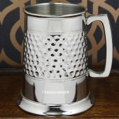 Engraved half hammered pewter tankard